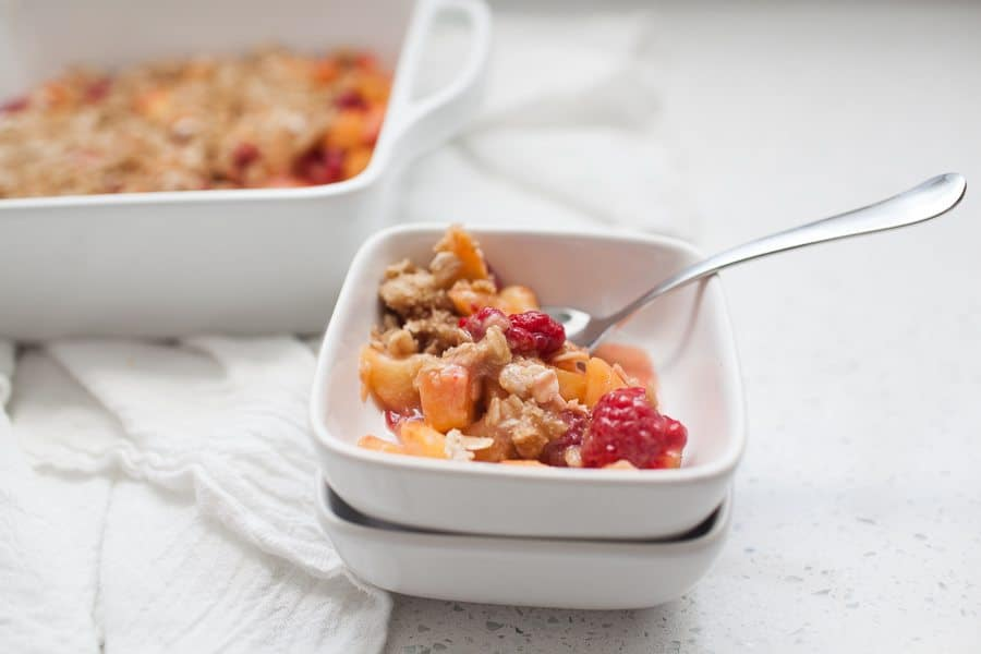 This peach raspberry crisp is the perfect summer dessert! It's light and fresh and perfect when served with a big scoop of vanilla ice cream. The crumble topping is so easy to make and really pulls the entire dish together. You'll love making this light fruity treat!