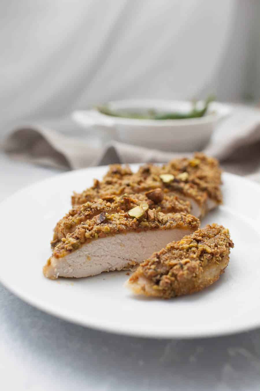 Switch up your normal dinner routine and give this pistachio dijon mustard chicken a try! You'll be surprised when your whole family can enjoy it. Even if you aren't a huge fan of pistachios or mustard usually (I wasn't either), I bet you'll like this combination! This fancy breaded chicken is baked in the oven so you can focus on the other parts of your dinner while it bakes.