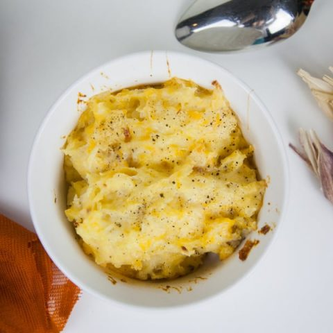 This recipe for Shredded Cheesy Potatoes is the perfect side dish for all of your holiday parties and family get togethers!