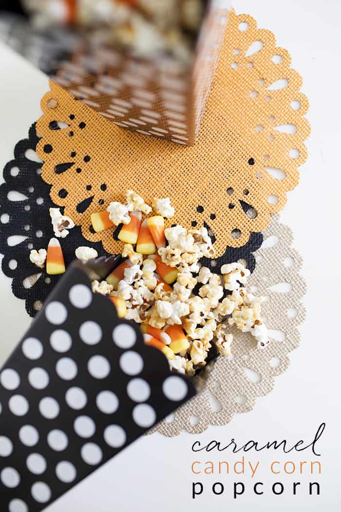caramel coated candy corn popcorn on black and orange doilies on a white background