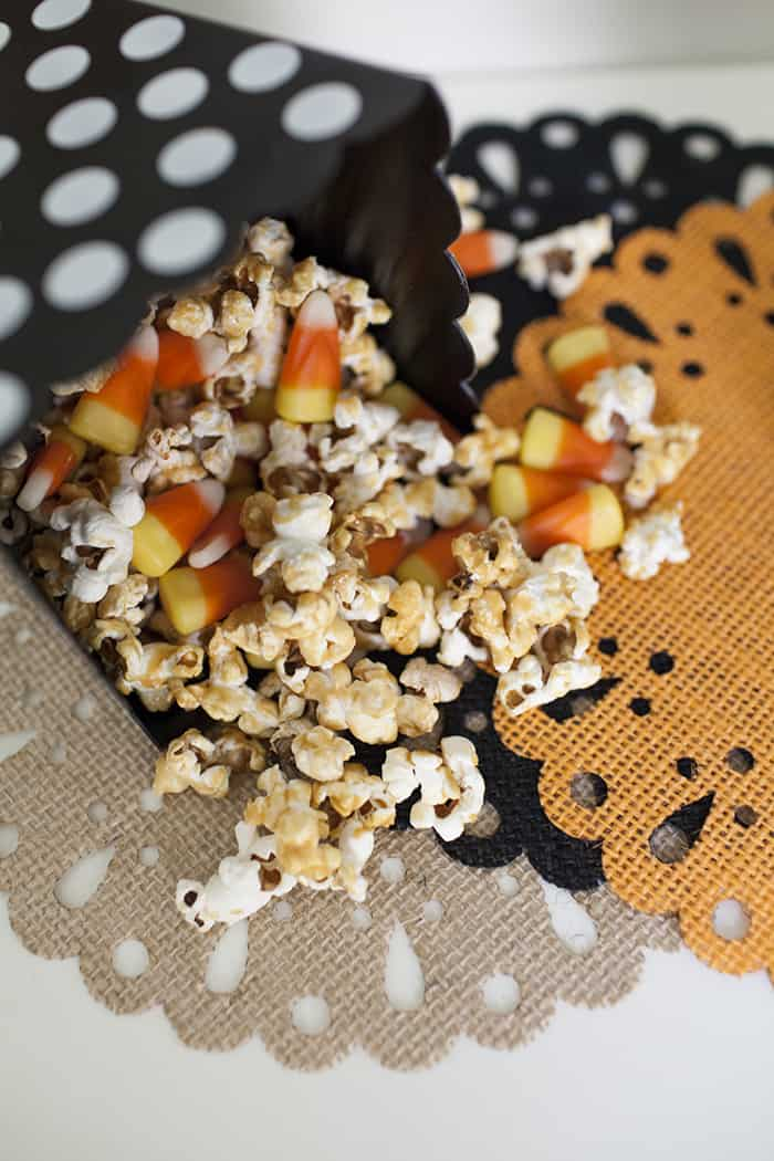 close up of Candy Corn Caramel Popcorn with caramel popcorn pieces and candy corn pieces mixed together