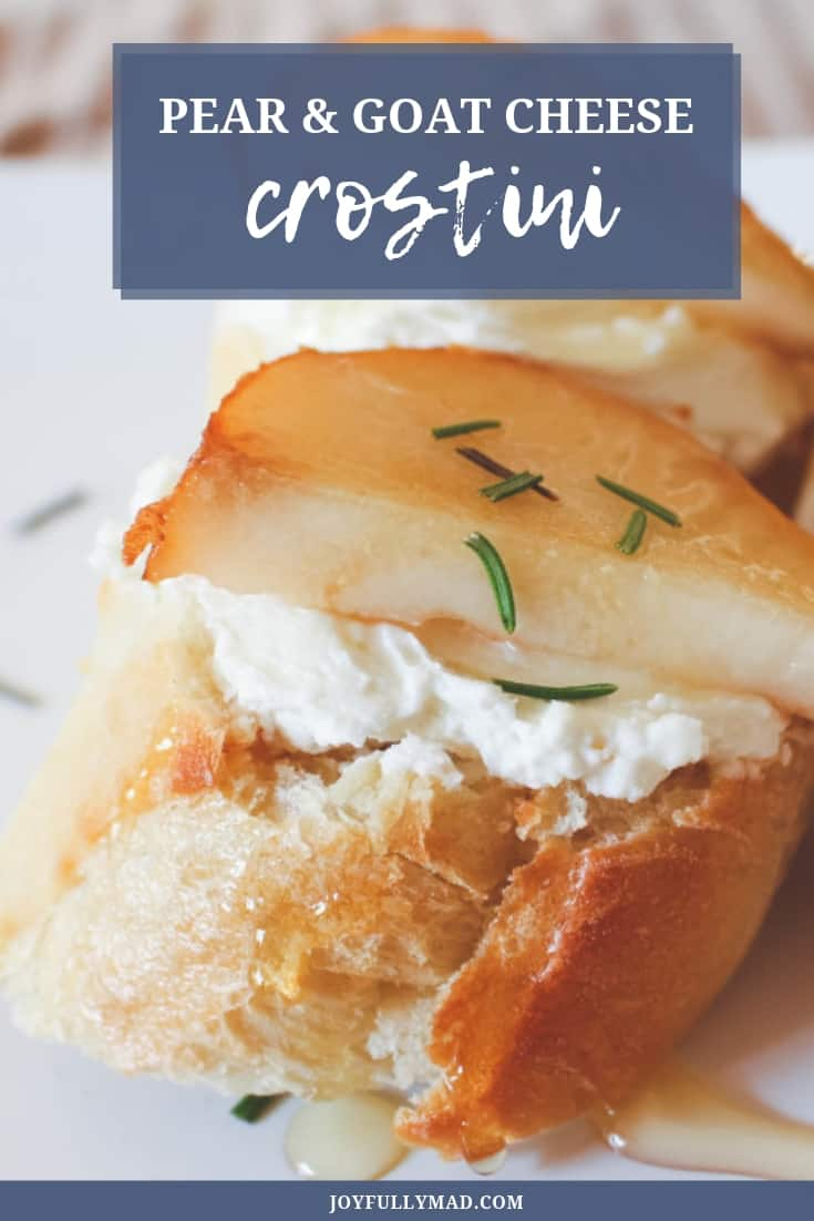 Pinterest image for pear and goat cheese crostini. Sliced baguette with goat cheese on top, topped with a sliced pear and sprinkled with rosemary.