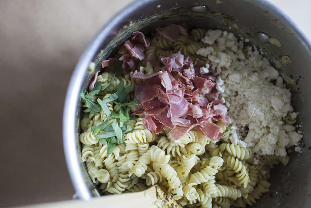 An easy, weeknight dish! Prosciutto, pesto and feta together with rotini pasta made into a weeknight dinner.