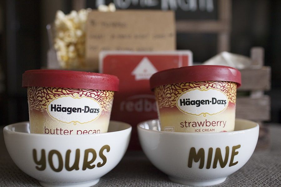 "This movie night date crate is the perfect way to have a date night at home while your little one is asleep! Share some popcorn, a movie and H?agen Dazs? ice cream in these DIY ""yours and mine"" ice cream bowls for a quiet date night at home."