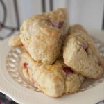 Super easy orange and fresh strawberry scones with a light orange and vanilla glaze.