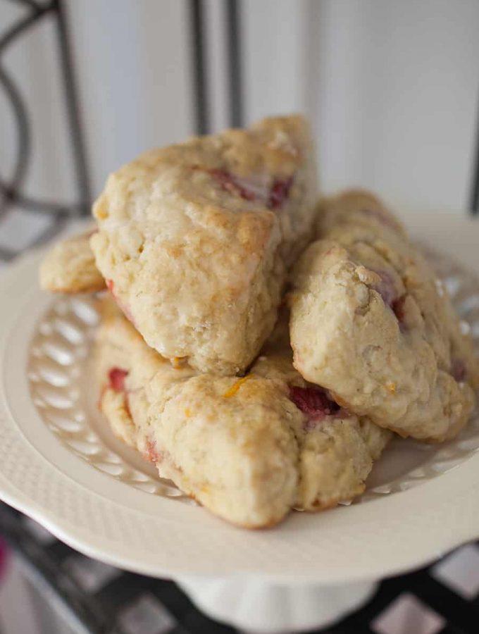 Super easy orange and fresh strawberry scones with a light orange and vanilla glaze.