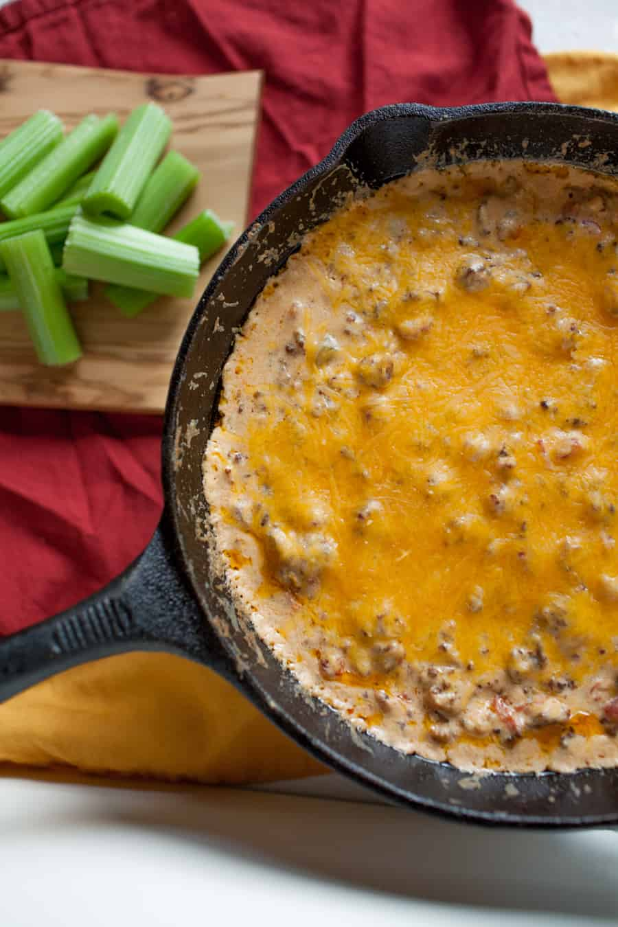 This skillet sausage dip is a must have for this football season. Perfect for football parties, tailgating or Super Bowl parties.