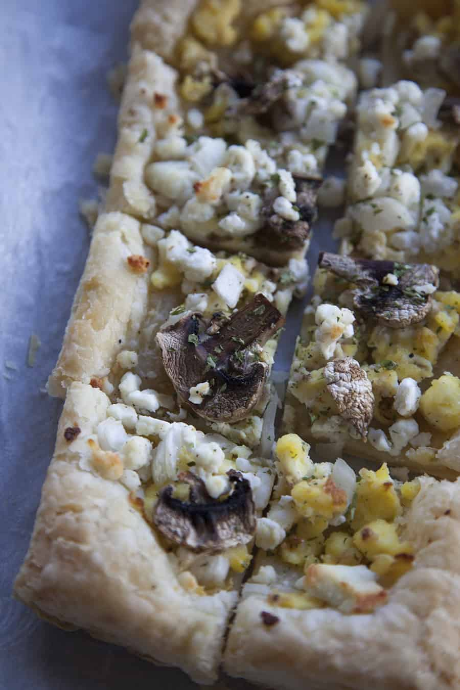 This easy breakfast puff pastry can be made ahead of time for a full week of breakfast! Scrambled eggs, mushrooms, onions and goat cheese all topped on a delicious, flaky, puff pastry.