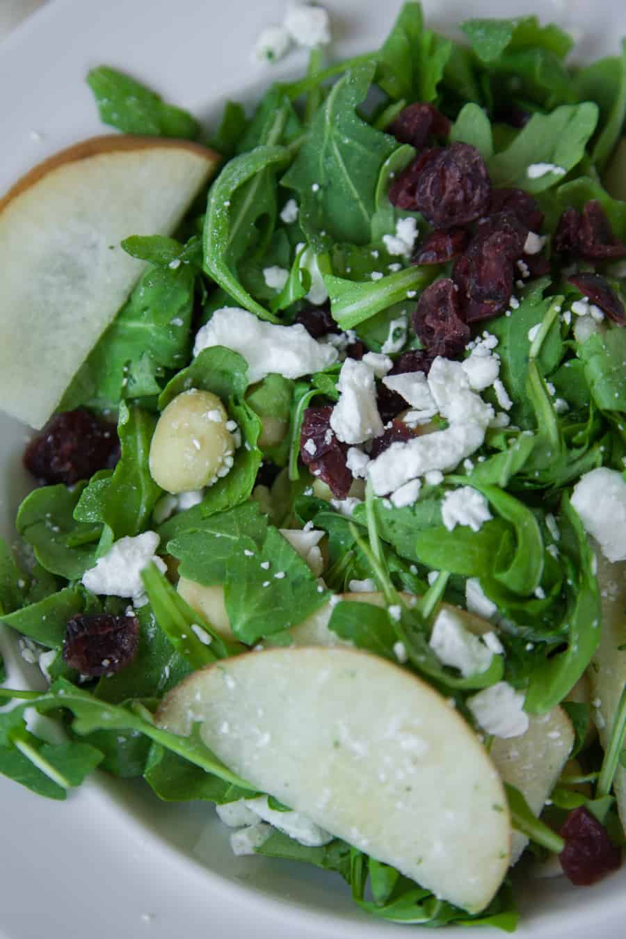 This light pear and pecan arugula salad is packed with sweet and salty flavors with a homemade vinaigrette dressing made with DRY Sparkling Cranberry! Add bosc pears, pecans, cranberries and goat cheese to a bed of arugula salad.