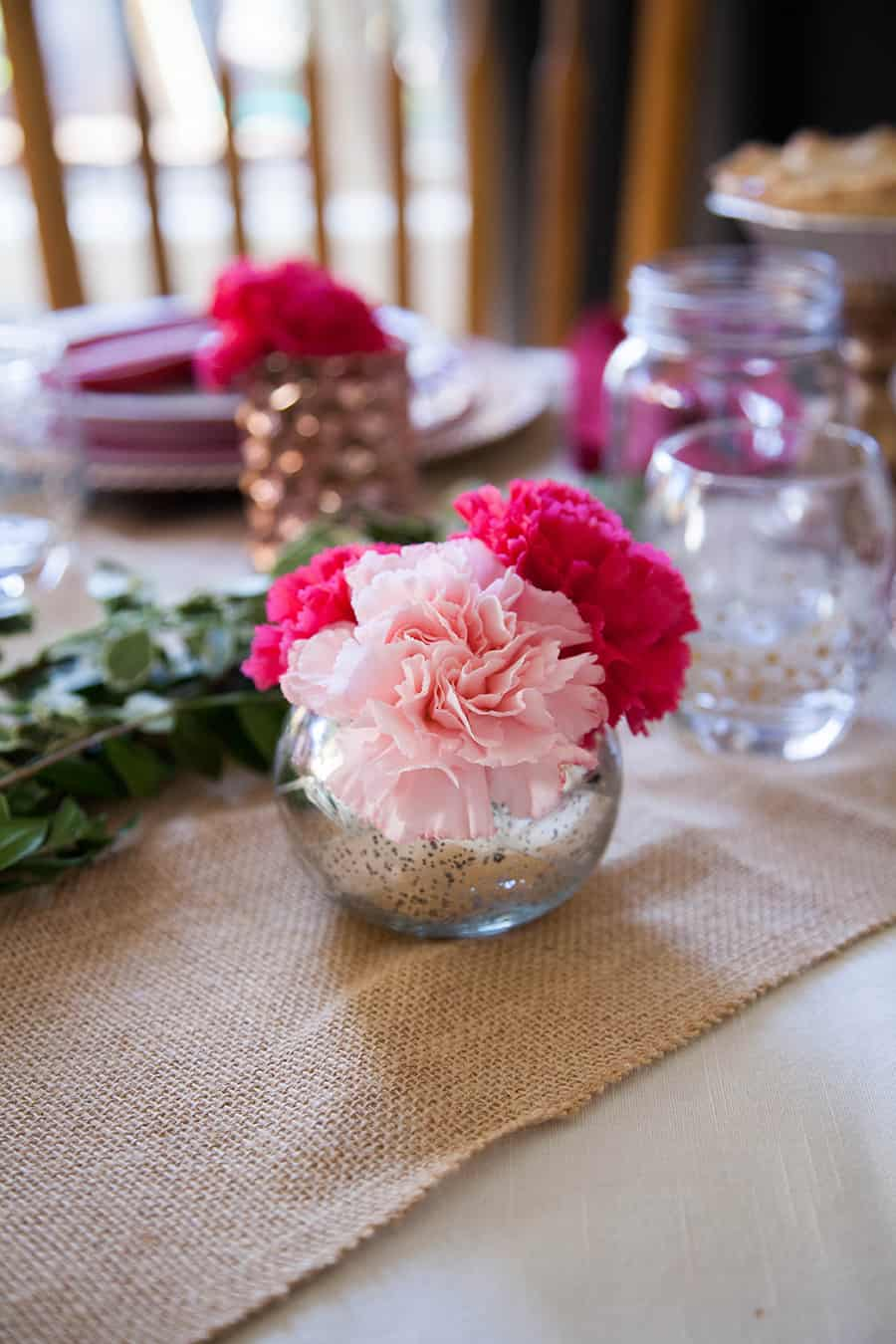 Looking for an easy date night in for Valentine?s Day this year? This easy tablescape is the perfect way to wow your sweetheart this year. Plan a gorgeous tablescape with stacked plates of different colors, mixed metals and fresh carnations for a stunning look! valentines day ideas | date night at home | date night | valentines day dinner | valentines day table | valentine's day decor | valentines ideas | steak dinner ideas