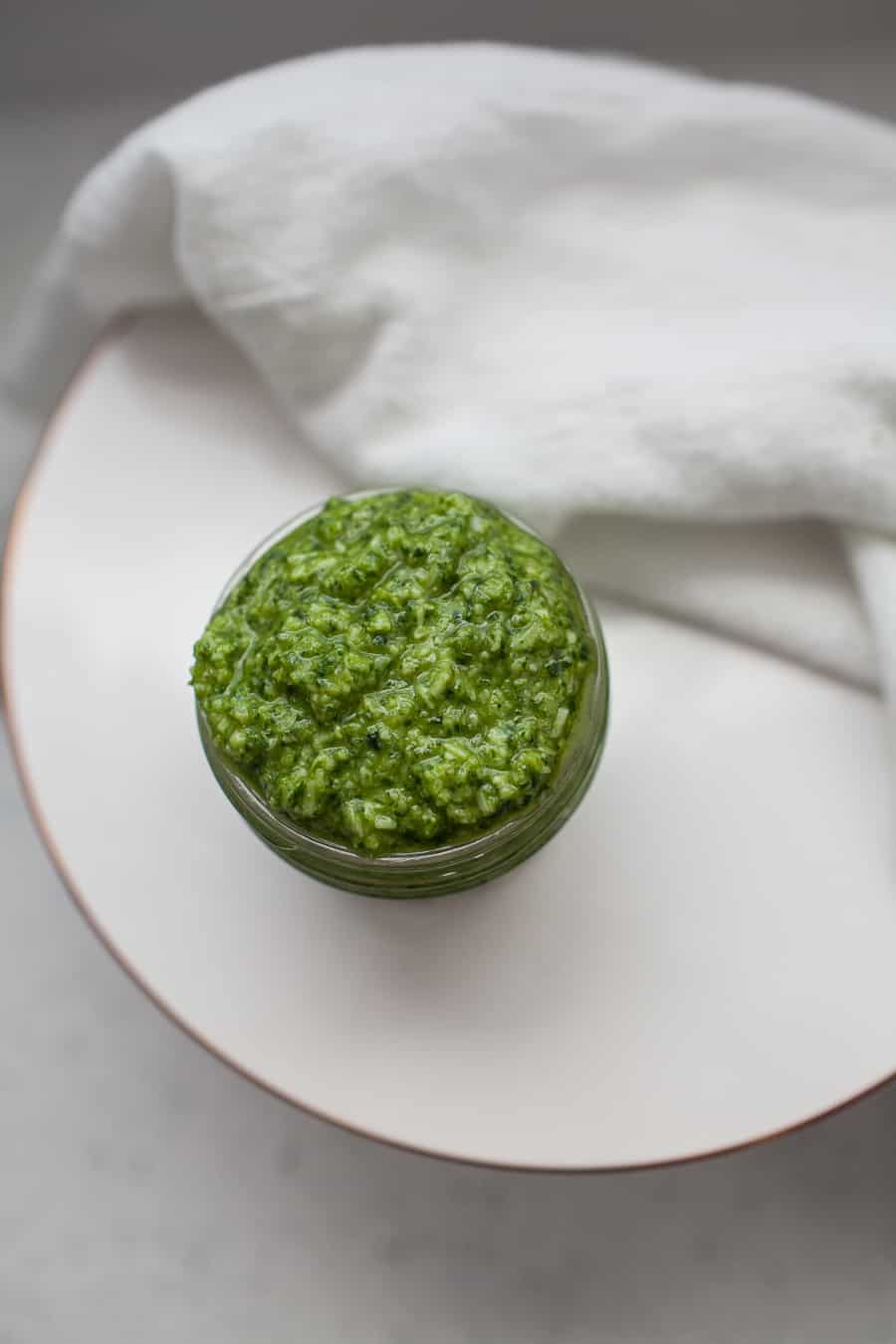 If you're a pesto fan, you're going to fall even more in love with pesto once you realize how easy it is to make it homemade! This homemade kale arugula pesto variation is a perfect peppery, smooth blend of pesto that you'll choose every time. Make this kale arugula pesto ASAP! homemade pesto | arugula pesto | kale pesto | kale arugula pesto | homemade italian sauces | homemade pasta sauce | pasta sauce recipes