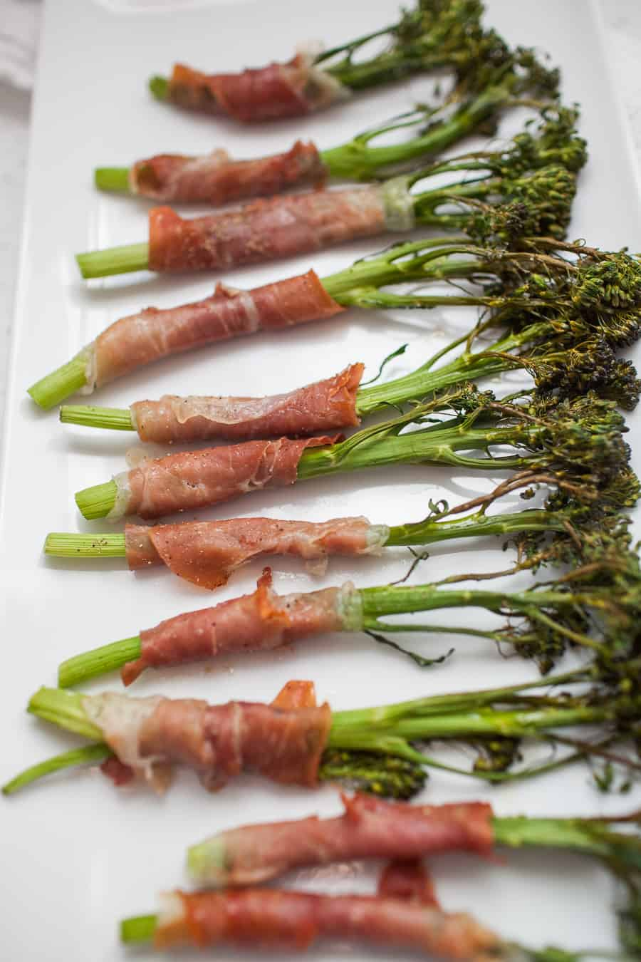 Prosciutto wrapped broccolini is the perfect side for pretty much any dinner! It's fancy, but incredibly simple to make with only two ingredients. Take 15 minutes to make this delicious side dish for dinner ASAP.?