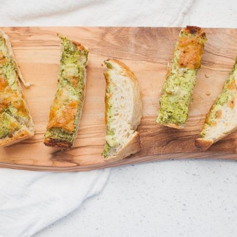 Cheesy Ranch French Bread makes a perfect pre-dinner appetizer! It's great for a crowd or just for your family while dinner finishes cooking. Made with homemade ranch dressing, this french bread is packed with fresh ingredients and will make the wait for dinner much more enjoyable.?
