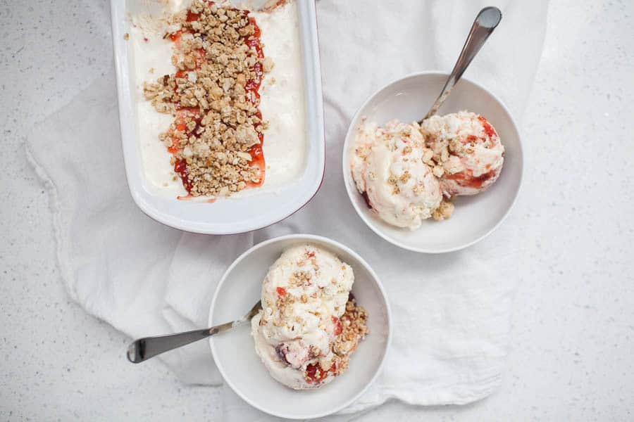 Summer is the perfect time for ice cream! If you don't have an ice cream machine, have no fear, this no churn ice cream recipe requires only?four ingredients for a light and delicious summer treat. Celebrate National Ice Cream Day with this Strawberry Granola Parfait No Churn Ice Cream!