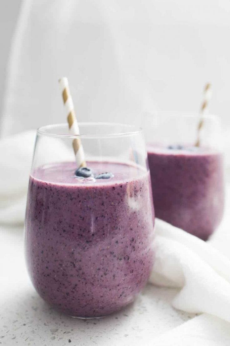 Smoothies are the perfect breakfast or snack to pack in tons of flavor and protein! Made with frozen blueberries, plain greek yogurt, spinach, flax seed and sweetened with a pinch of honey, this Blueberry Greek Yogurt Smoothie is perfect for the whole family.?