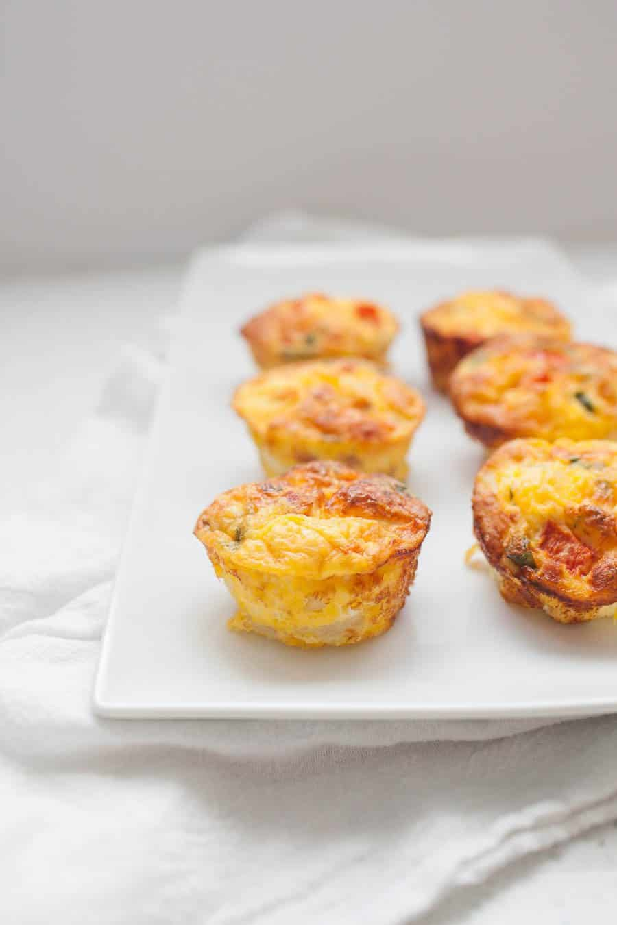 Simplify your breakfast routine with Make Ahead Breakfast Frittata Muffins. With this delicious recipe, you'll have breakfast prepped for the week. These frittata muffins are packed with flavor and you can even customize them to use up the vegetables you have on hand.