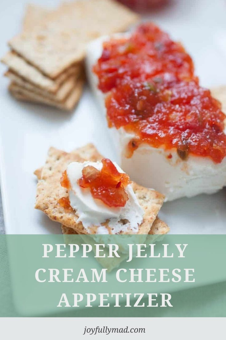 Pin graphic showing close up of cream cheese appetizer on a cracker and the title overlayed as text.