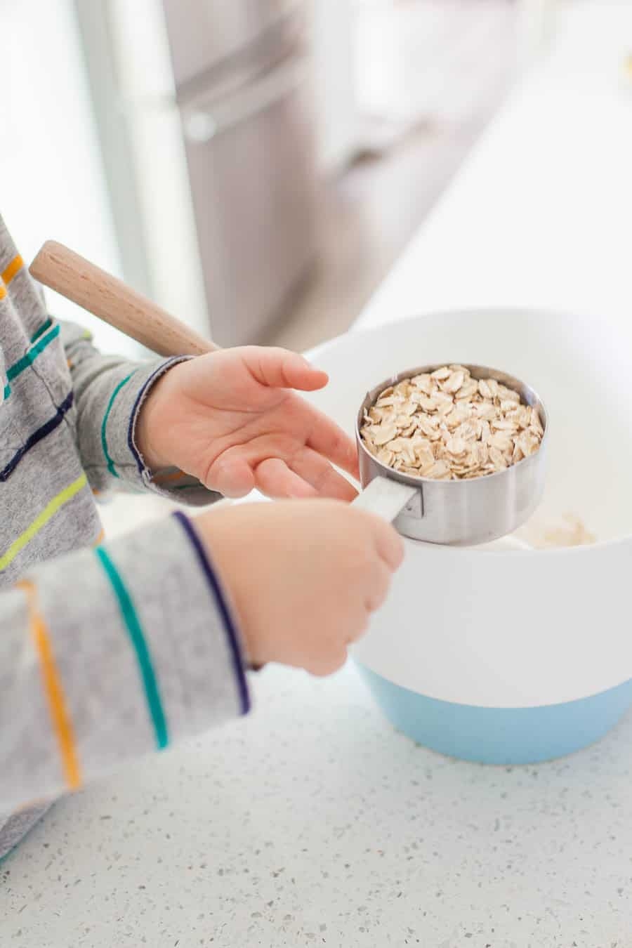 Teaching your toddler to help in the kitchen can be a daunting task, but it's one that can take away the stress of having to keep an eye on your kiddos while trying to prep dinner or a snack. Teaching your little ones about being in the kitchen can be fun and stressless with a few quick tips for cooking with toddlers!