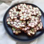 No Bake Stained Glass Window Cookies are made with melted butter butter and chocolate chips plus colorful mini marshmallows. The mixture is rolled into logs and sliced into one inch thick cookies. This quick recipes makes enough for a crowd so this recipe is perfect for all of your holiday gatherings!?