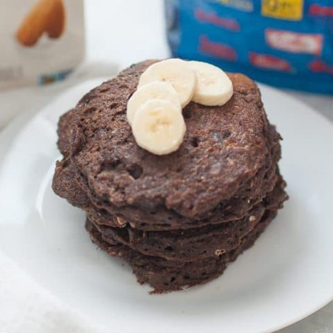 Gluten Free Chocolate Oat Pancakes are the perfect morning indulgence! These gluten free pancakes are surprisingly healthy, without a lot of added sugar even though they taste like a bakery brownie! Top your stack of pancakes with bananas and a drizzle of maple syrup and enjoy a slow morning with these dessert worthy pancakes. These pancakes are made with dairy free milk, gluten free flour and oats, but are easy to customize with your own dietary needs. Regardless of how it's customized, these pancakes are sure to be a treat.?