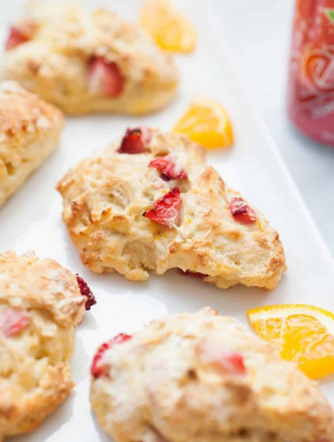 Scones don't have to be sugar filled and overly sweet-- these healthy strawberry orange scones have no refined sugar, just natural fruit and stevia to sweeten them! They're light, fluffy and have the perfect amount of strawberry and orange flavor. These healthy scones are the perfect breakfast or snack for the entire family!?sugar free scones   healthy scones   strawberry orange scones   stevia scones   strawberry scones   healthy orange scones   healthy strawberry scones   sugar free baking   stevia baking   sugar free scone recipes