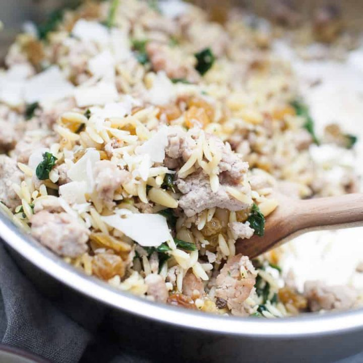 Spinach Turkey Orzo is a super easy meal that is packed with flavor for a perfect quick dinner option! This orzo dish has ground turkey, spinach, pine nuts, golden raisins and is topped with olive oil and shaved parmesan. The complexity of flavors in this dish is amazing, but you don't have to spend a long time getting this dinner together!
