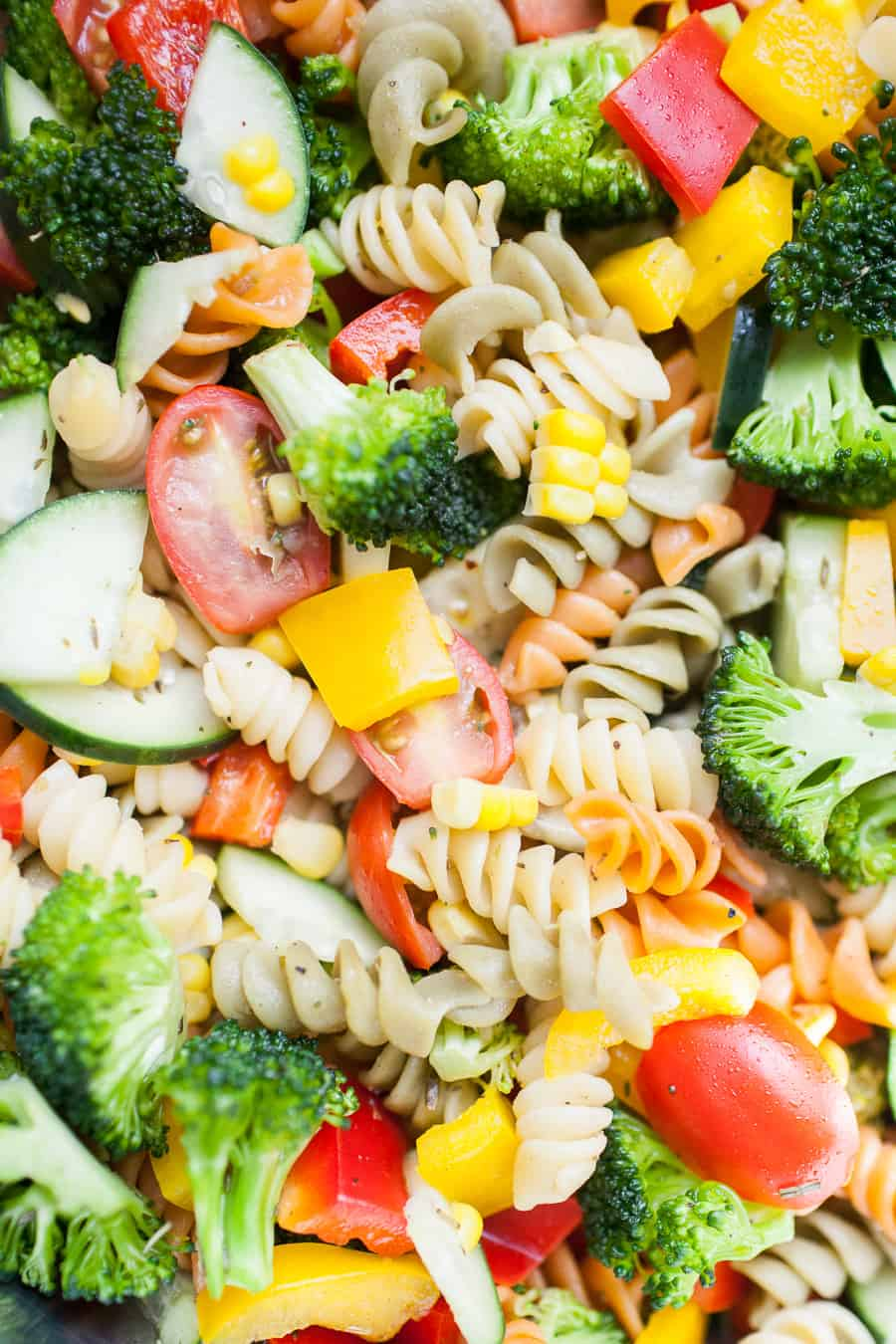 Veggie packed pasta salad is a perfect side dish for any occasion. It's great for the warmer weather for potlucks outside and perfect for brightening the colder months, too! The pasta salad is made with a mayo-free dressing and packed with vegetables like cucumbers, bell peppers, tomatoes, corn and topped with feta cheese.?