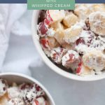 Fruit Salad with Whipped Cream is the perfect side dish or dessert! It's made with grapes, bananas and apples and homemade whipped cream, sweetened with a bit of honey, so this dish is perfect for the whole family. #holidaysidedish #holidays #easter #fruitsalad #coolwhip #whippedcream