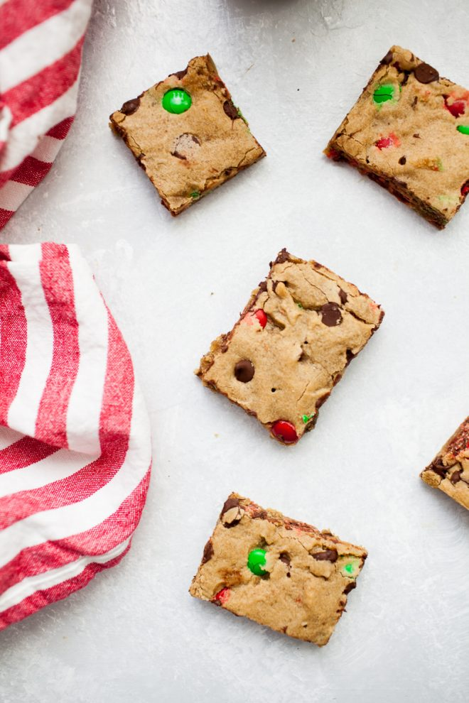 2 cookie bar squares with red and white striped cloth from above.