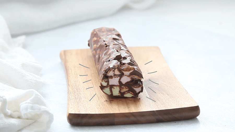 Chocolate covered cookie log with mini colored marshmallows inside.